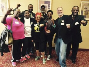 Members of newly elected slate of USW 8751 with Pam Africa (center), May 9.