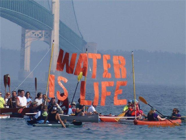Flotilla protesters set out under the Mackinac Bridge, Sept. 6.Photo: Nancy Haun.