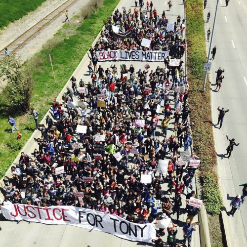 Hundreds take to the streets of Madison May 13 in response to the non-indictment of Matt Kenney, the killer cop that on March 6 murdered Tony Robinson, a 19-year-old Black student.