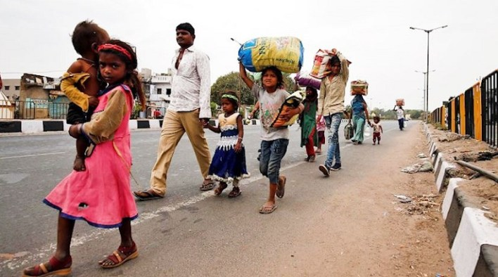 stranded workers walk through roads