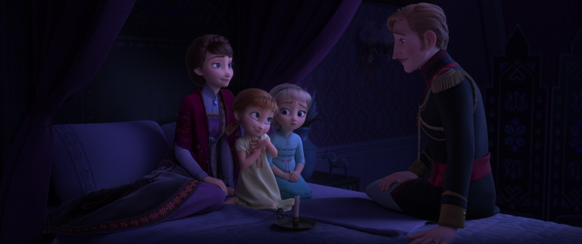 Young Anna and Elsa listen to an epic story.