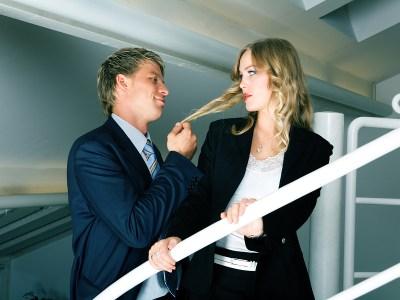 bigstock-man-harassing-his-female-cowor-12187241