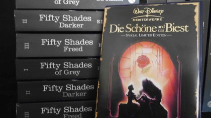 Books of the Fifty Shades trilogy with a DVD of Beauty and the Beast