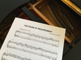 Sheet music of Harry Potter music The Room of Requirement on a piano