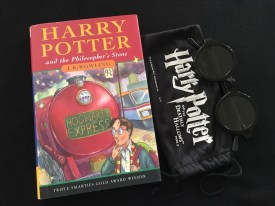 Harry Potter and the philosopher's stone book with cinema 3D glasses