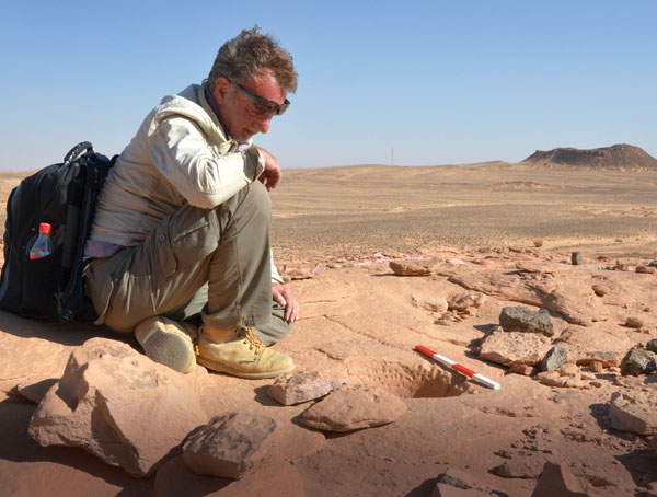 Bristol University's Nick Saunders, in characteristic thinking pose, surveys the terrain on site in Jordan.