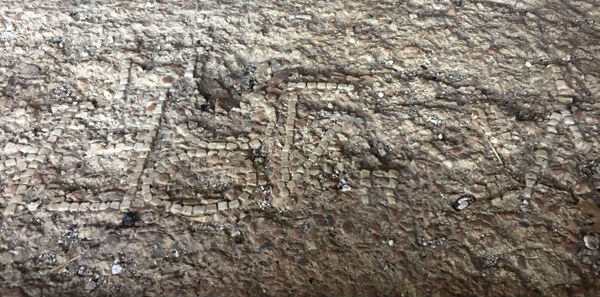 Oscan lettering on the floor of the small brick temple at Schiavi d'Abruzzo.