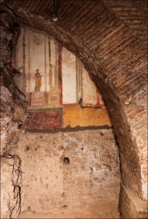 Within the labyrinth of tunnels that spreads out from under the Basilica of St John Lateran are remarkable traces of structures that ended up entombed beneath the world's first cathedral. The walls of elite houses, such as that pictured, still have fragments of frescoes clinging to them. Now, for the first time, a project is studying these buildings as a group.