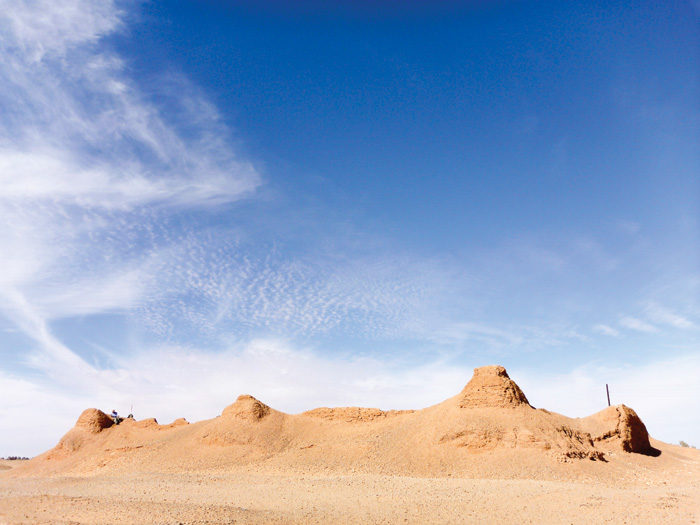 Mud-brick fortification stands out against the blue sky in Libya's desert