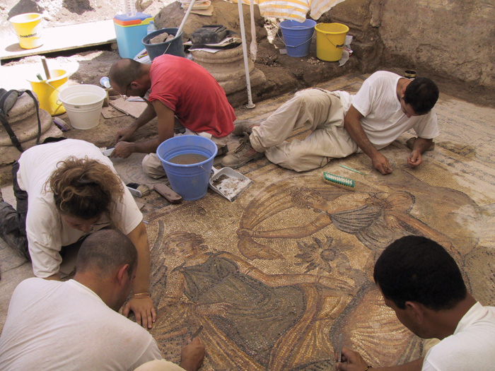 Archaeologists treating mosaic showing the Rape of Europa