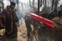 4004BF1400000578-4480494-Today_crowds_watched_on_as_servicemen_carried_41_crimson_coffins-a-1_1494100734204