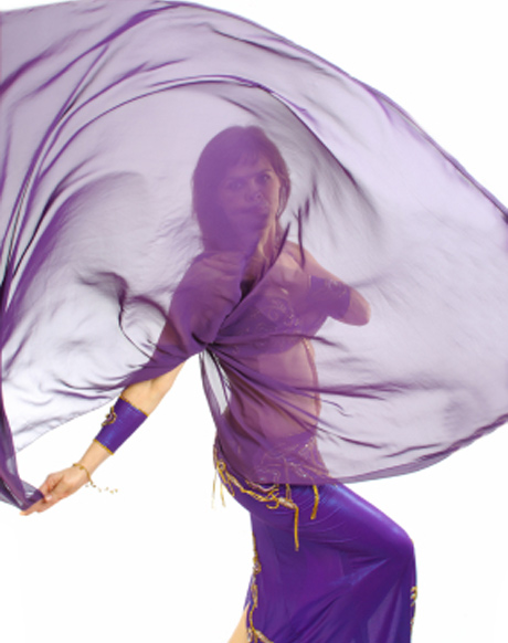 Dancing with a veil. Belly dance with veils.