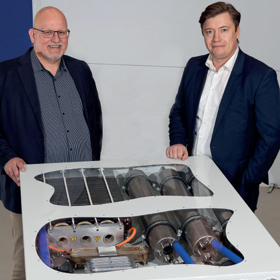 Mads Friis Jensen,and Lars Bo Andersen, with HTPEM fuel cell at Alfa Laval Test & Training