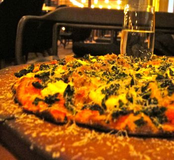 The Spicy Pork Sausage, Kale and Pecorino Pizza is a residence speciality atMercato.