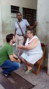Dr. Rodrigo D'Aurea being greeted by yet one of his elderly patients on the street. The community health worker looking on.