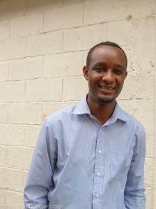 Mengesha, AHOPE Ethiopia's Director smiles for the camera.