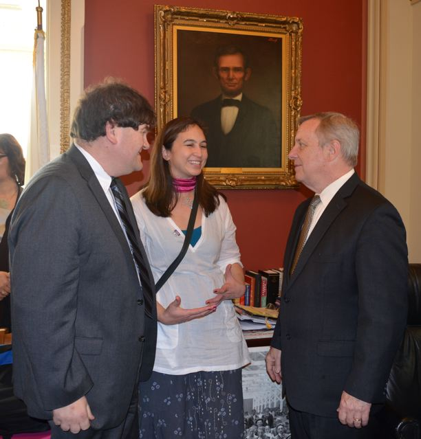 Cynthia and fellow RESULTS activist Richard Smiley talk to U.S. Senator Dick Durbin of IL about microfinance