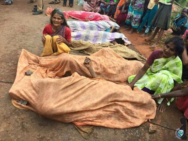 Dead bodies are covered as women mourn. Over 500 people have lost their lives in the Chennai Flood.
