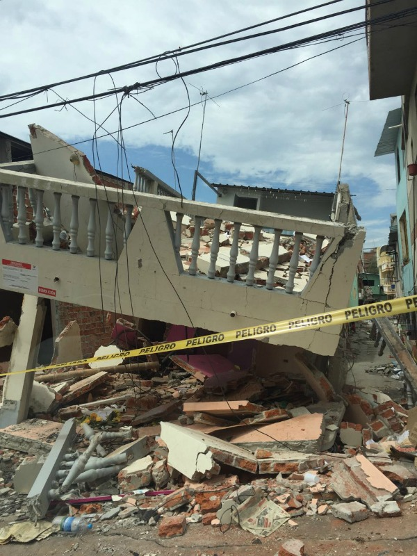 """Yellow tape marked """"Peligro"""" warns people of danger after the roof and balcony collapse of a building in Manta, Ecuador after the earthquakes in April 2016."""
