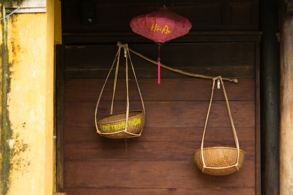 Traditional shoulder bamboo baskets hanging on wall