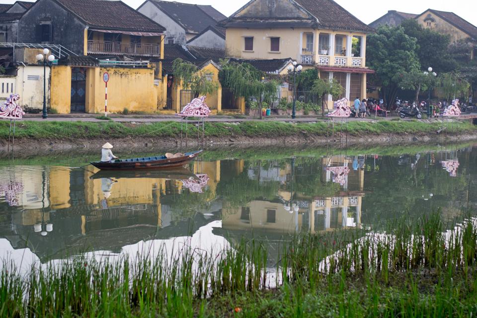 Vietnamese woman rowing down Phuoc An River