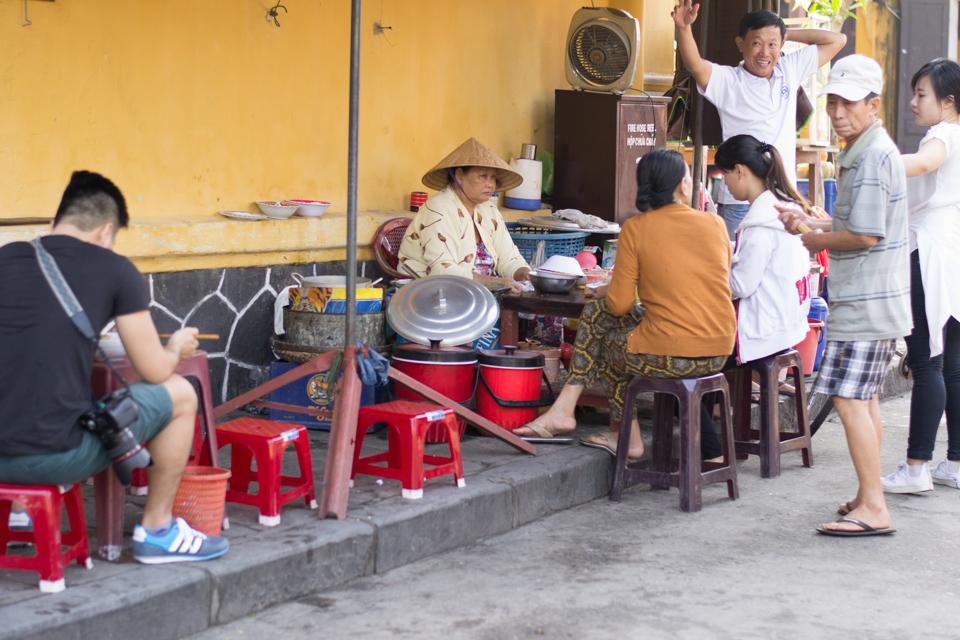 Vietnamese patrons having their morning breakfast outside