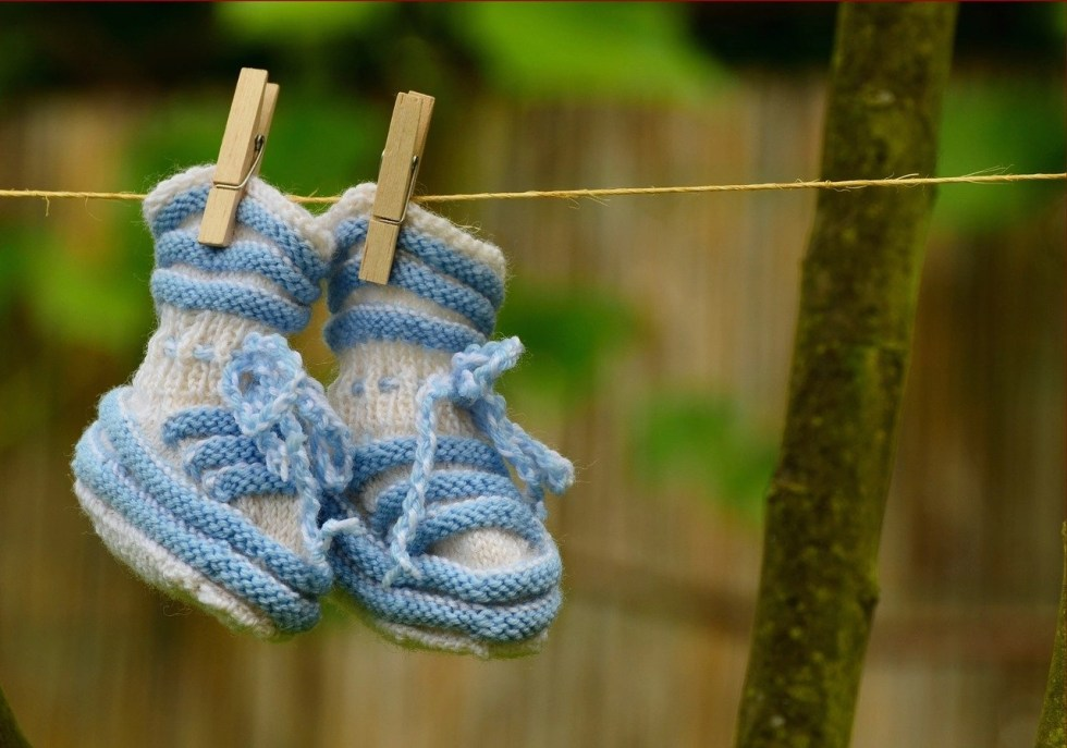 Blue baby shoes to take baby steps to a digital detox