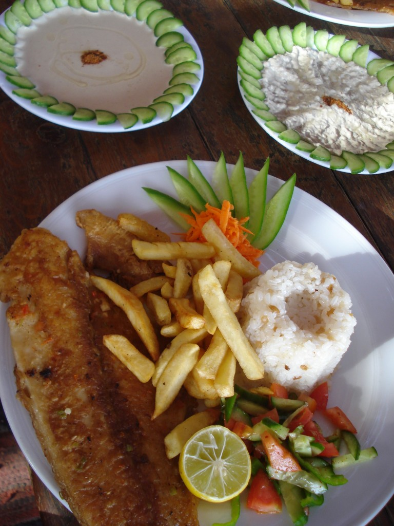 Fresh fish, french fries, rice and vegetables served at a restaurant at the Blue Hole, Dahab