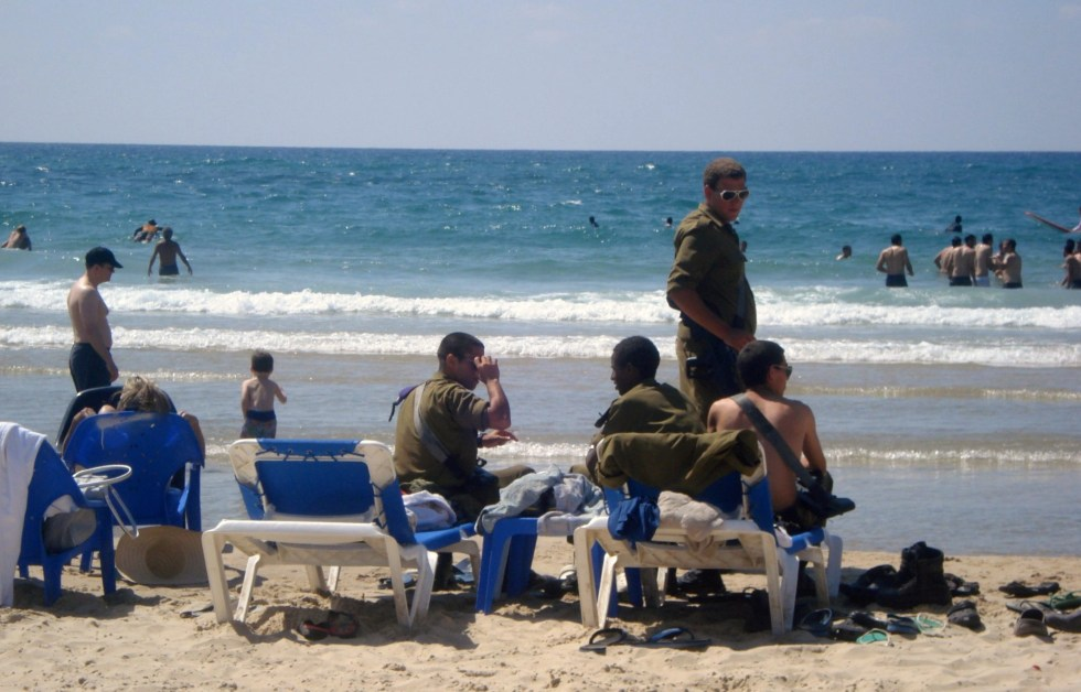 Isareli soliders on a beach in Tel Aviv, which you may see on a trip to Israel