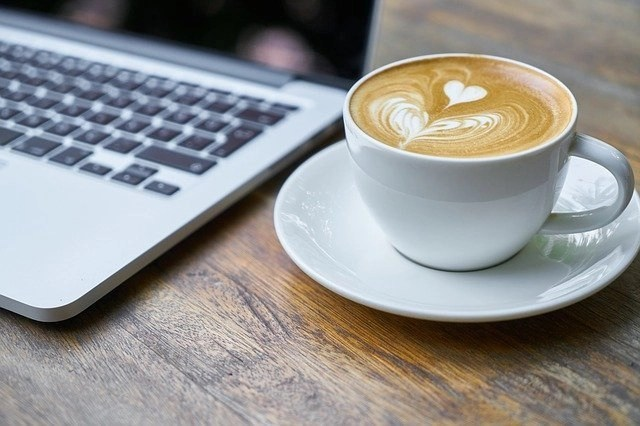 8 Content Writing Tips On A Laptop With Cappuccino