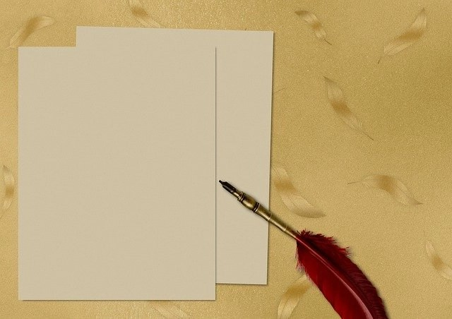 Paper and red quill pen for freelancer writers, one of 15 ways to freelance online without a degree or experience