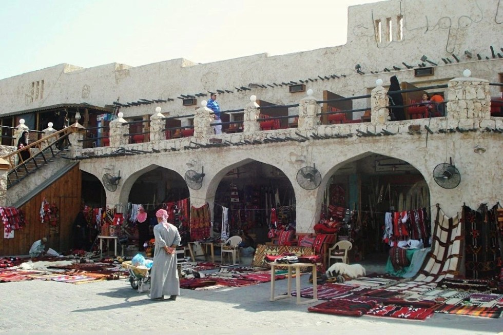 Rugs and other goods set out on the ground at Middle East marketplace Souq Waqif in Doha, Qatar