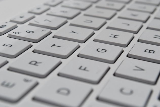 White computer keyboard for freelance proofreading online