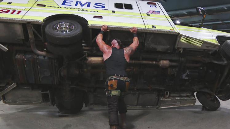 braun strowman tips over an ambulance on wwe raw 11th april 2017