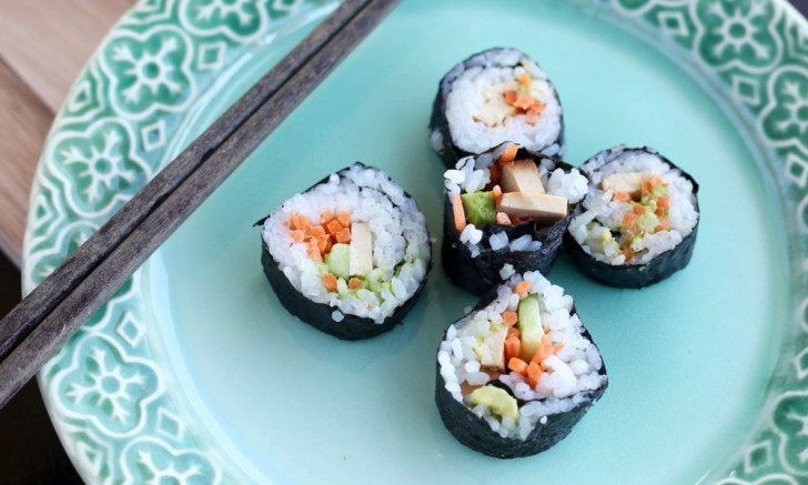 Vegan sushi rolls with vegetables, tofu, and avocado