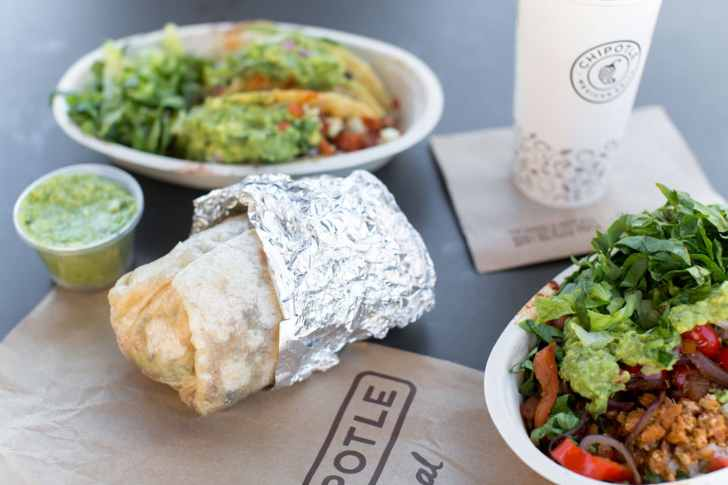 Vegan Chipotle Burrito Tacos and Burrito Bowl and a Side of Guacamole on a Table