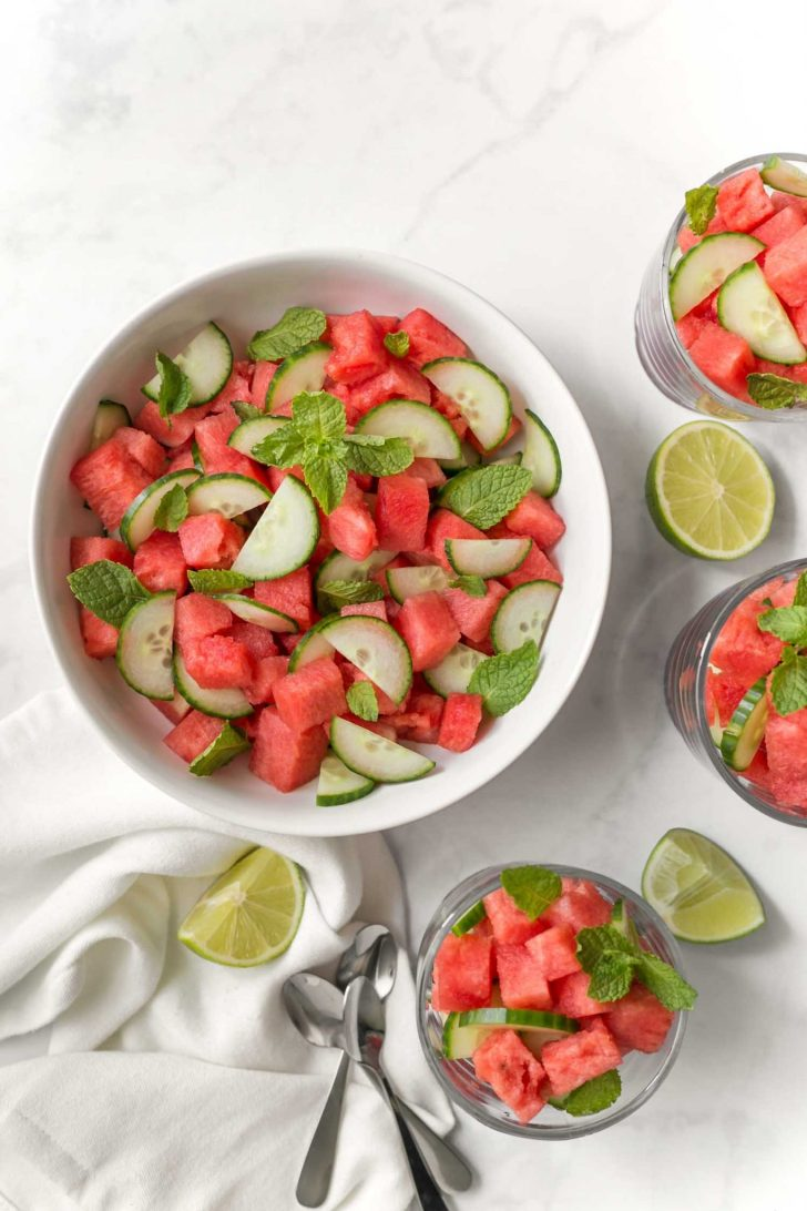 Easy Cucumber Melon Salad Served in Bowls With A Side of Lime