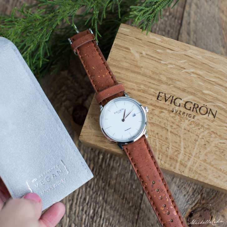 Evig Gron Watch Vegan Watch Brand on a Wooden Watch Box and a faux-suede Watch Case With PETA Approved Vegan Label