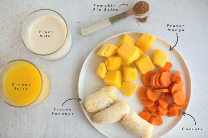 Halloween Smoothie Ingredients Flatlay Carrots Banana Mango Milk Orange Juice