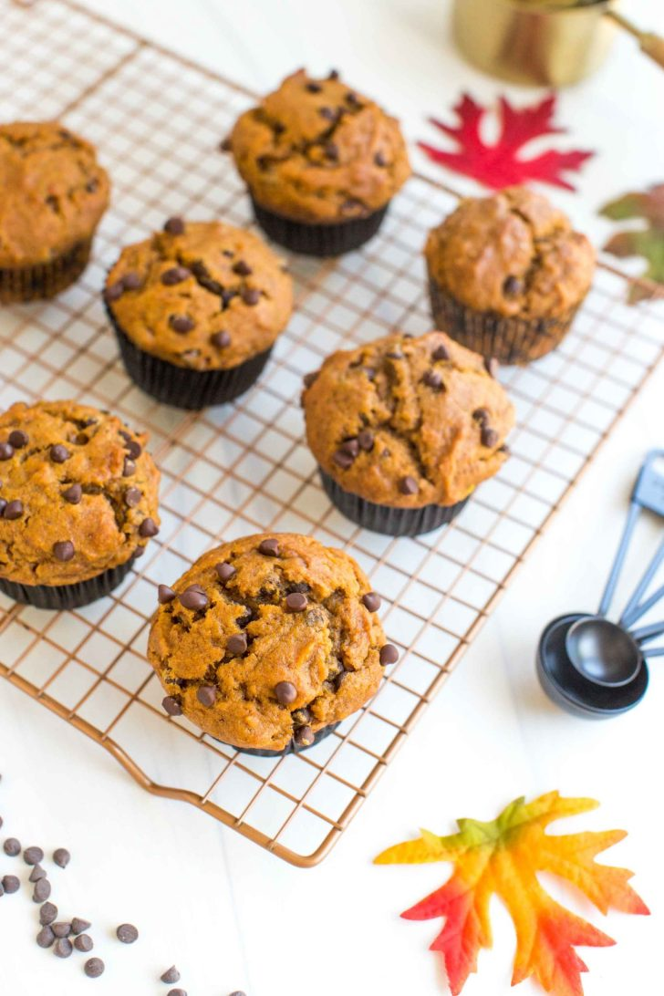 Vegan Pumpkin Muffins On a Gold Wire Cooling Wrack