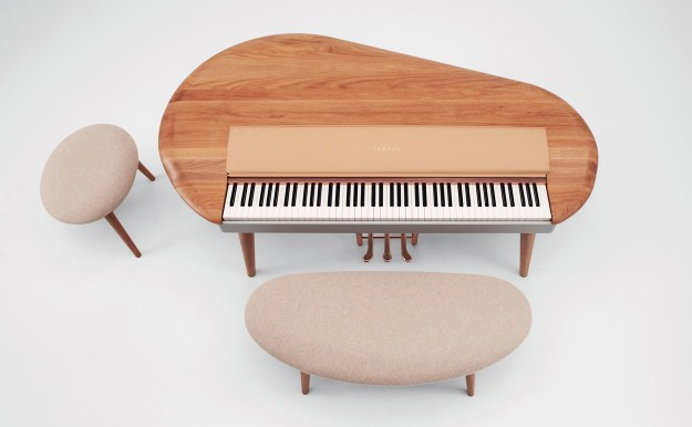 Yamaha's A-Round digital piano from above with two stools