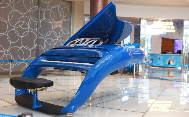 The Schimmel K208 Pegasus grand piano with integral stool