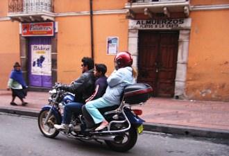 Three Up Quito Biker