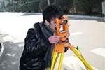 Land surveyor looking through transit courtesy of Pixabay.com