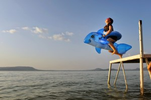 leaping off pier into Lake Balaton Hungary - @World Travel Mama
