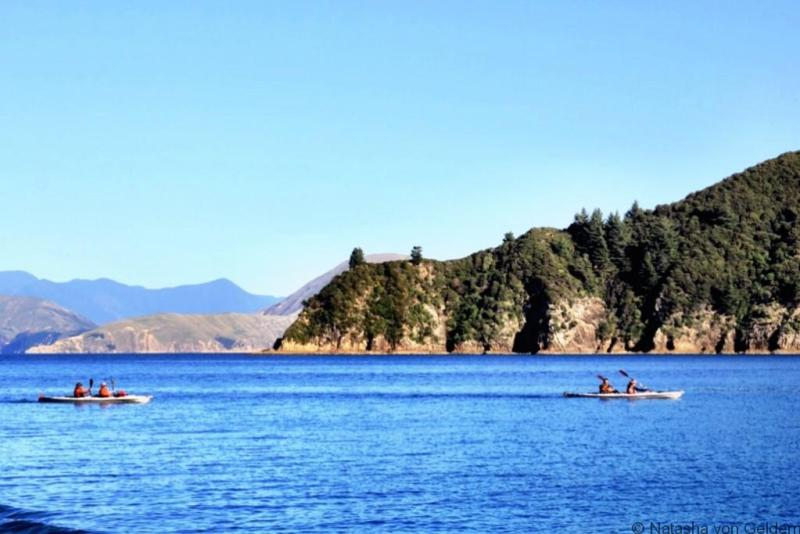 Sea kayakers in Marlborough Sounds New Zealand web