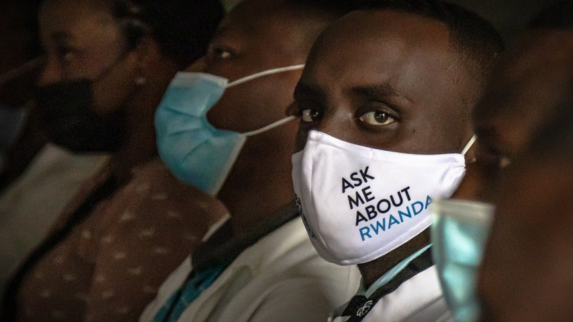 Resident in 'ask me about Rwanda' mask