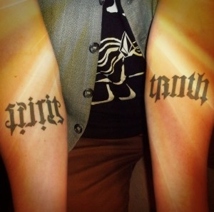 "Tattoos that say ""spirit"" and ""truth"" on Ortiz's forearms"