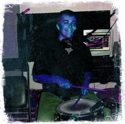 Zach Compton smiling with drums