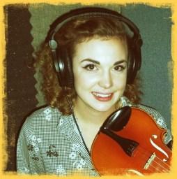 Samantha gates holding a violin